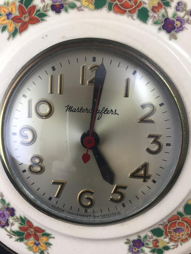 Horloge murale en céramique avec des rouages de la Mastercrafters état 01978 de fonctionnement