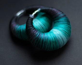 Ear weights | thread wrapped hoopla for gauges | ear plugs | piercing freaks :)