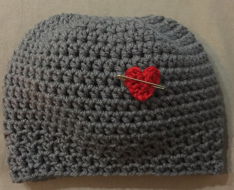 9edc8b675fdc0 Messy Bun Beanie with removable pin with heart. Please send a