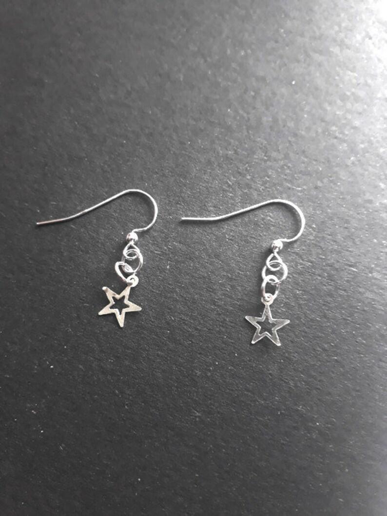 Sterling silver open star earrings