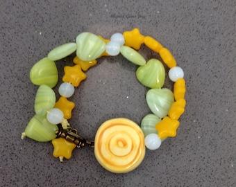 Joyful Bracelet: Ceramic bullseye, Pressed Glass, Antiqued Brass