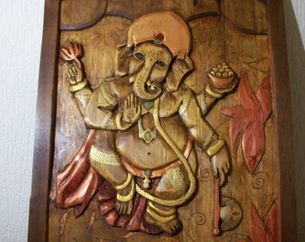 Ganesha .Carved wood panel