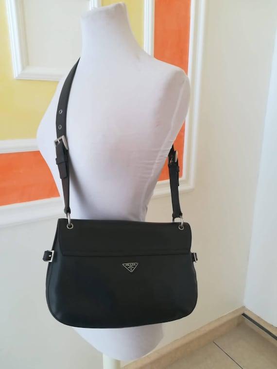 Prada, blue leather post bag bag.