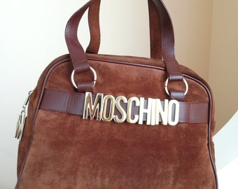 Moschino, suede bag and leather bag.