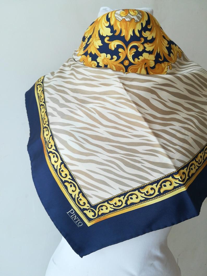 wholesale dealer 8a8e9 c2602 Pinto foulard vintage in seta blu e oro