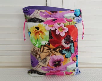 Anemones, daisies and butterflies on my pouch.