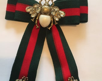 Designer inspired green and red stripe with pearl and rhinestone and pearl bee center and 2 small bees ribbon brooch pin