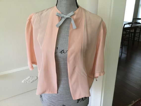 Vintage peachy pink bed jacket