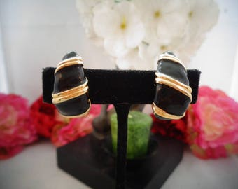 Vintage Black Enamel and Goldtone Clip On Earrings. The Earrings are Elegant and comfortable to wear. Am Adding More Photos 1/12
