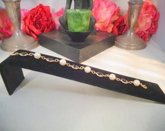 "Vintage 7.25 Swarovski Bracelet with Black Bezel Crystals and Real Pearls. This Bracelet has a Swan Tag. Measures 7.25""."