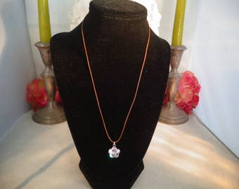 "Vintage Swarovski Crystal Pendant w/Brown Cord. The Crystal is Clear & Floral Shape. It is 20+"" w/ Brown Cord w/Silver Tips"