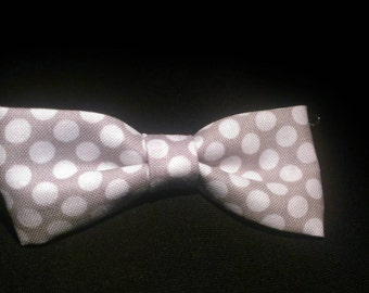 Gray and white polka dot fabric bow with alligator clip