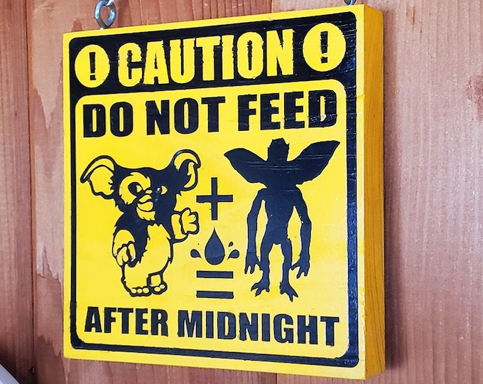 Featured listing image: Do Not Feed After Midnight Gremlins Home & Garden Sign | Nerdy House Decor, Geeky Wall Hanging, Nerd Signs, Gremlin Movie Geek Pet Gift