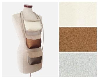 Leather shoulder bag in imitation champagne, silver or bronze