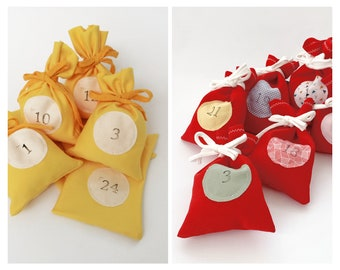 24 yellow or red advent calendar bags with stamped calendar numbers