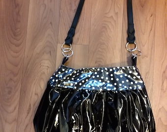 Black and polka dot purse with should strap