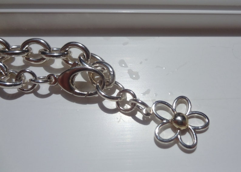 The Superstar Sterling Silver Daisy with 14KT Yellow Gold Ball Center on a Super Chunky Sterling Silver Link Bracelet