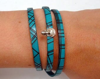 Green leather strap bracelet with skull jewelry