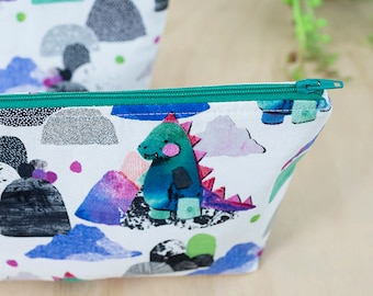 Dinosaur zipper pouch. Dino pencil case. Makeup pouch. Small cosmetic case. Cute dinosaur bag. Toiletry bag. Travel pouch. Dinosaur gift