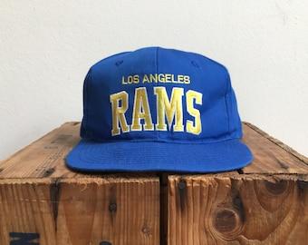 5c5c8865e6f 90s LA RAMS Snapback   Vintage 90s STARTER Arch Script Snapback Hat   Los  Angeles Rams Vintage 90s Draft Snapback