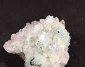 Prehnite, Quartz, epidote and babingtonite on Amethyst crystal geode cluster E170173
