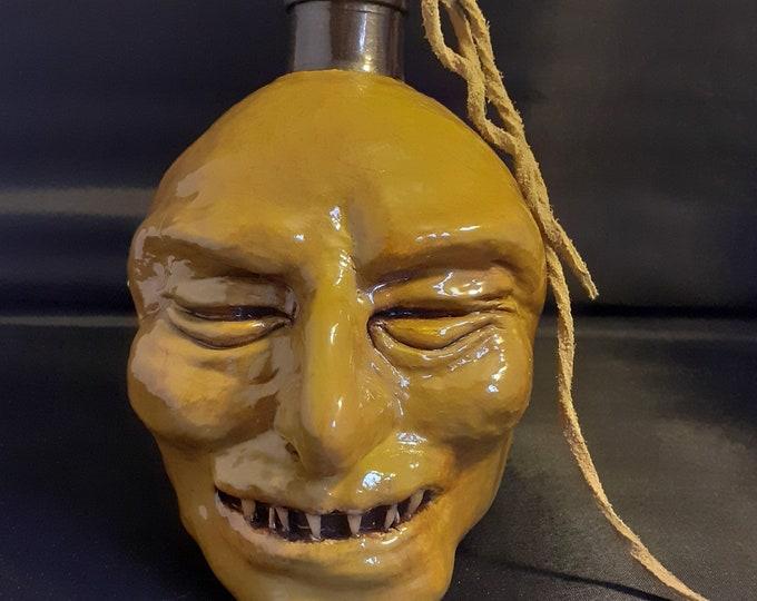 Grinning Voodoo Bottle