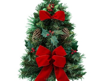 artificial christmas tree on easel with holly and pine cones with red bow cemetery christmas tree cemetery flowers tr2266