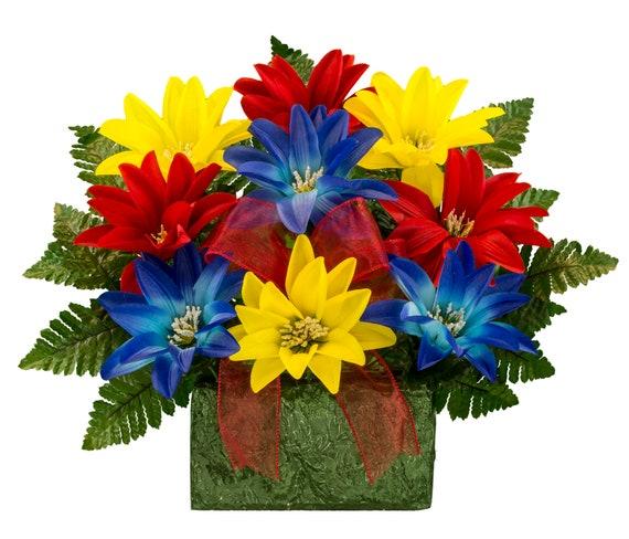 Red yellow and blue dahlia monument brick flower arrangement mightylinksfo