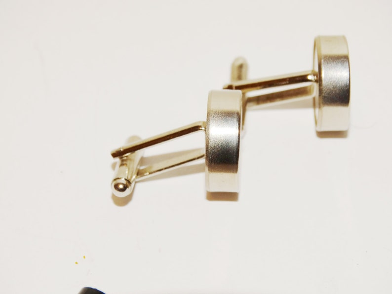 Love me Love me not cufflinks made from stainless steel.