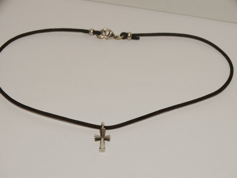 James Avery Sterling Silver Cross Leather Necklace.