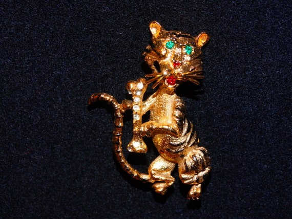 Gold Tone White & Green stones Tiger Brooch.