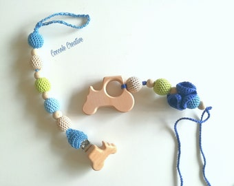 "Bottle holder, teething game, pacifier clip, holder clip ""Allegro Tractor""-gift idea birth, lactation and teething"