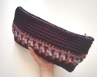 Purple clutch bag with contrasting insert-crochet webbing pouch