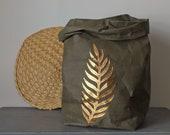Palm leaf design, gold leaf, washable paper bag, botanical print, aplique, hamper, laundry, living room, home decor