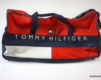 f6aecb5b94adb4 Vintage 90s Tommy Hilfiger Flag Logo Large Duffel Bag Duffle Travel Bag  Rare High Fashion 90s Fashion Designer 25