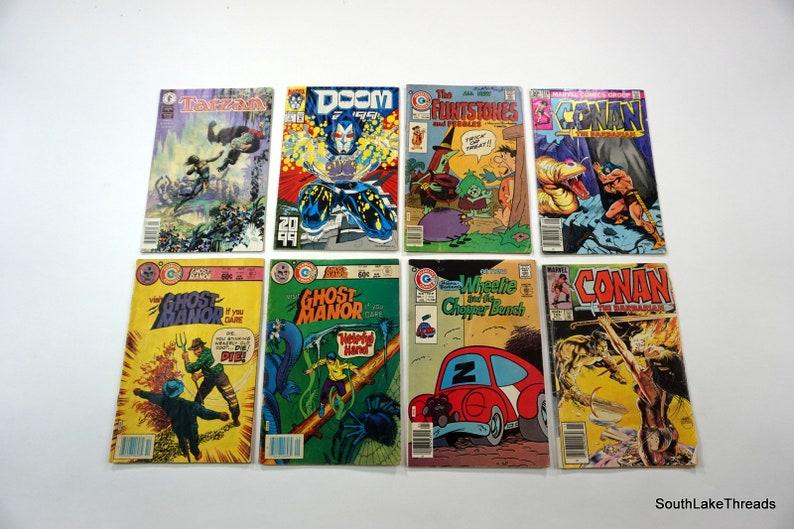 VTG Comic Book Lot 8 Ghost Manor Doom 2099 Conan Tarzan image 0