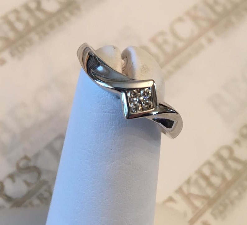 Vintage 10k white gold ring 4 Round Diamonds Channel Set in Marquise Top  with Ribbon Twist Shank  04 tw size 7