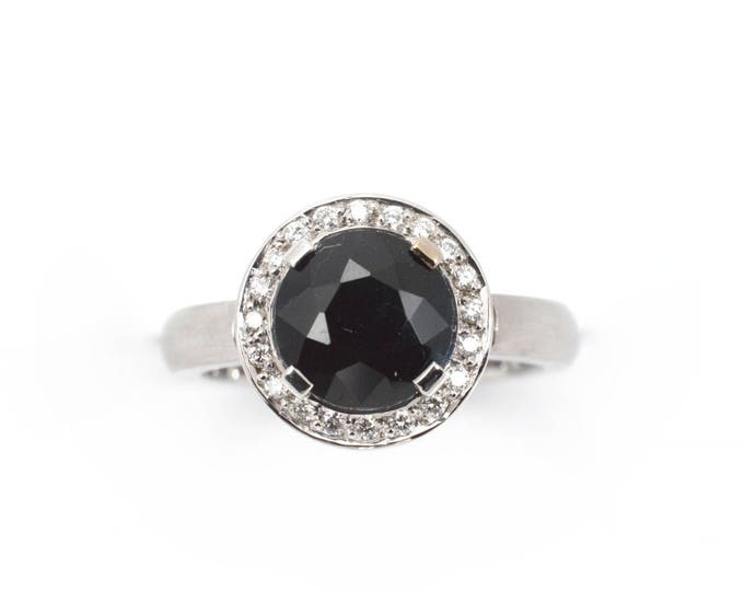 Classic ring black Sapphire 2.50ct, Diamonds totaling .15ct, in18kw gold (solid) dress or engagement ring. Price includes shipping insurance