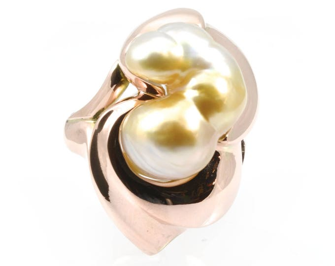 South sea Keshi pearl ring, carved ring in 9ct pink gold (12gms).
