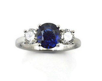 Sapphire and diamonds in platinum,1.17ct sapphire 2 diamond shoulder stones H/SI diamond total .63ct. Price includes shipping insurance.