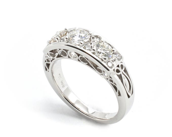 Filigree classical diamond ring in18ct white gold. Diamonds totalling 1.05ct quality HSI