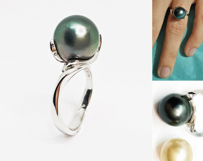 11mm Pearl, sterling silver solid, black tahitian, or cream south sea pearl. Can  be made with white pearl or in gold or add diamonds POA