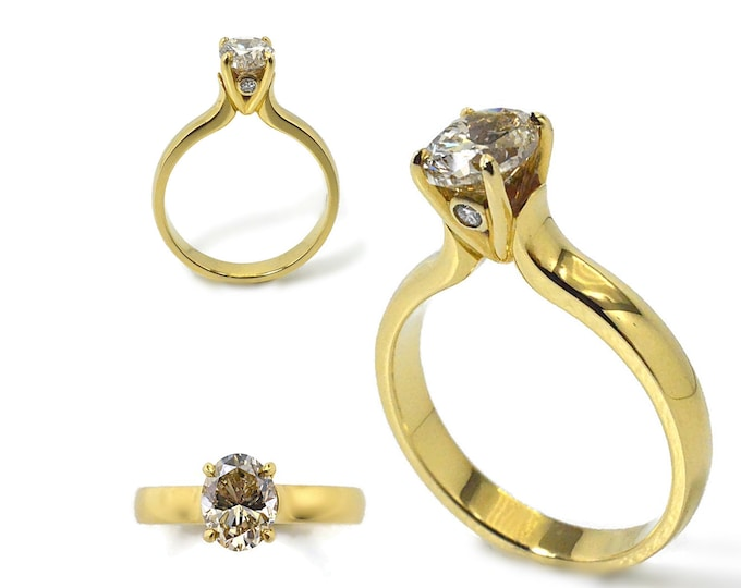 Diamond .93ct golden brown, centre stone comes with a IGI report. Two small diamonds on side of setting. 18k solid yellow gold, 7mm high