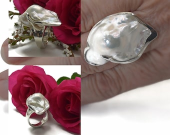 Hand carved baroque Pearl ring , good quality FW pearl size 30mm long 21mm wide 15mm deep in solid sterling silver 15gms, one of a kind.