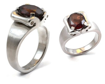 Garnet, and diamond, 4 champagne diamond, set in the sides of  the scrolls, sterling silver (solid) beautiful ring both classic and modern