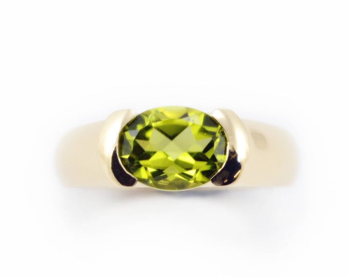 Regina 9K yellow solid gold 9x7mm natural peridot around 2ct .
