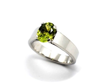 Snow 9K solid gold Peridot natural mined green peridot 9mmx7mm around 2ct ,Snow Whites ring beautifilly hand made in yellow or white gold.