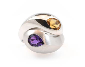 Amethyst and  Citrine natural stone, sterling silver solid ring. Different, lovley, and comfortable to wear.