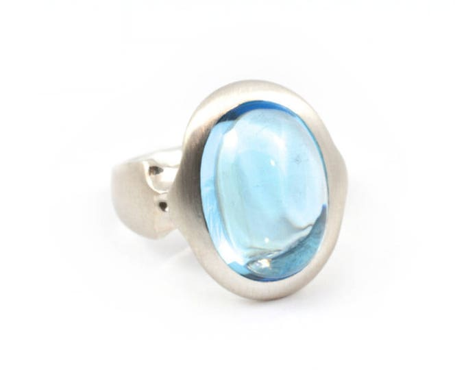 Topaz set in sterling silver ring.