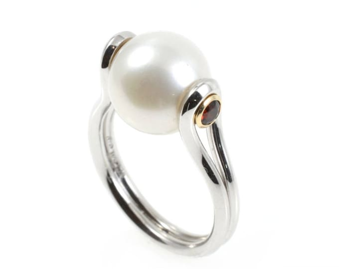Pearl 10.5-11mm sterling silver with garnets set in 9k yellow gold. It is a fresh-water pearl  the stg sil and gold are solid.